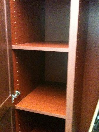 Diamond Resorts Grand Beach: storage in the pantry area with washer and dryer