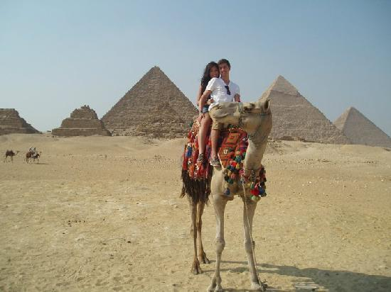 Aqua Blue Sharm Excursions - Day Tours: Typical Camel ride photo with Pyramid backdrop.