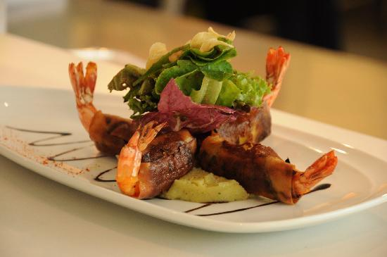 PizzaZo Bistro: 12.	Tiger Prawns - wrapped with eggplant, fried roll served with anchovy brandade, garlic chips,