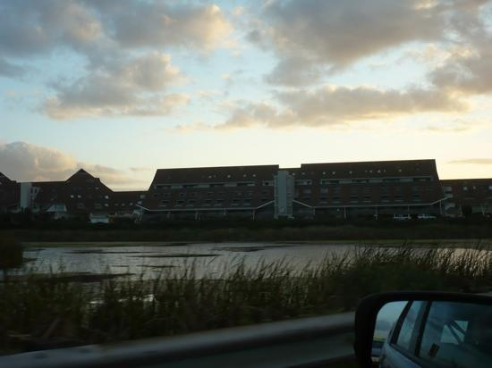 Dolphin Beach Hotel: view of the front hotel with the sun going down in the background