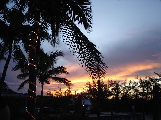 Aquamarine Beach Houses: Sunset at Tiki Hut  Wed. rib night = Great
