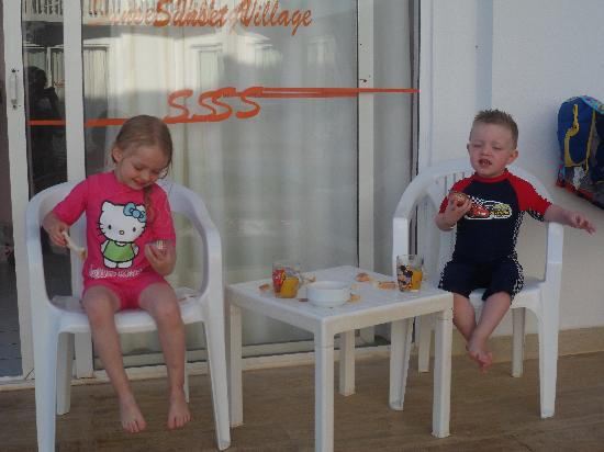 Sunset Village Apartments: my son and his wee friend he made, on the balcony