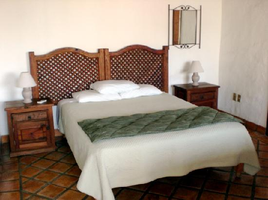 Bugambilia Blanca Vacation House and Condos: Penthouse level second guest bedroom, queen bed, private bathroom