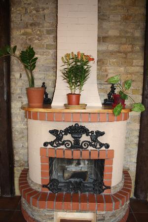 Alzana : Wood burning stove in another room