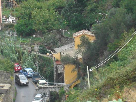 Il Pirata Rooms : The building we stayed in as seen from the trail high above the village