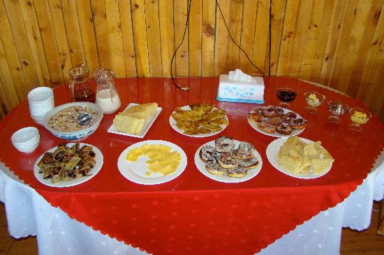 Mongolia: our breakfast was simple-- granola, pastries, bread, cheese, potato pancakes, eggs, sliced meat,