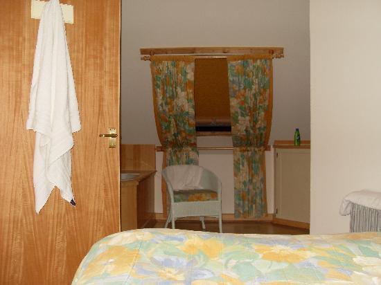 Open plan bedroom with huge bath, vanity and loo.