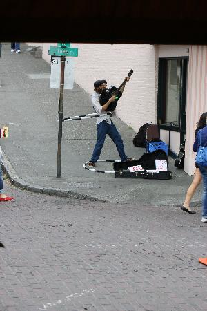 Pike Place Market: Street Busker - guitar, hula hoop and vocals