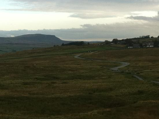 a view looking back from the path to Whernside with the Station Inn on the right and Pen-y-Gent