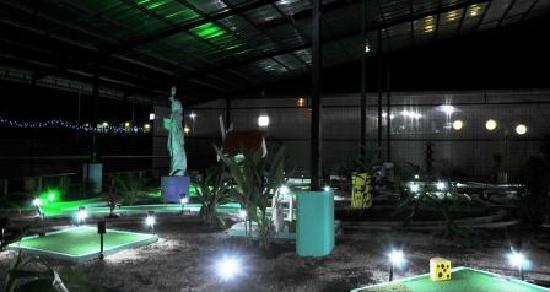 Reno's International Mini Golf & Amusement Center: Overall view of the course at night