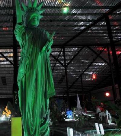 Reno's International Mini Golf & Amusement Center: Statue of Liberty lit up at night