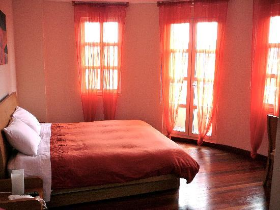 """Hotel Casa Deco : The Naranja room, called a """"junior suite"""", but it isn't really--though it does have a balcony."""