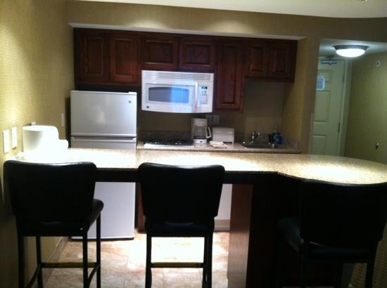 Comfort Suites Park Place: full kitchen with bar seating.