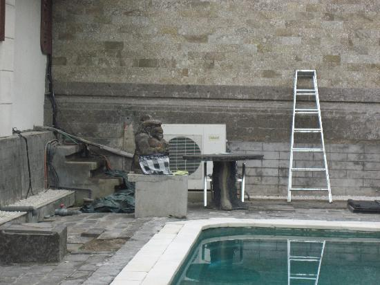 even more construction materials in pool/staircase area - Picture of