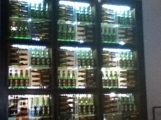 La Fiesta Authentic Mexican Restaurant: Interesting display of beer bottles between walls