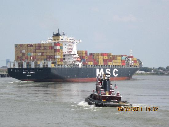 Steamboat Natchez: Container ship and tugboat heading down river