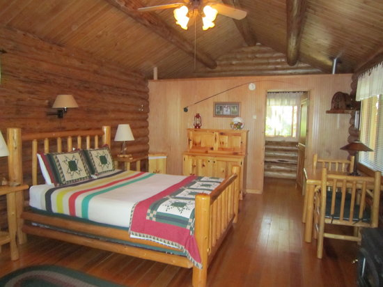 "Silverwolf Log Chalet Resort: the pine cupboard on the back wall is the ""kitchen"".  Self-catering not encouraged?"