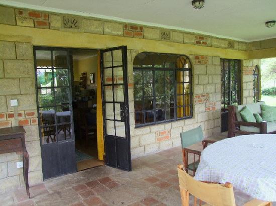 Kembu Cottages: The Verandah Porch overlooks the grounds.