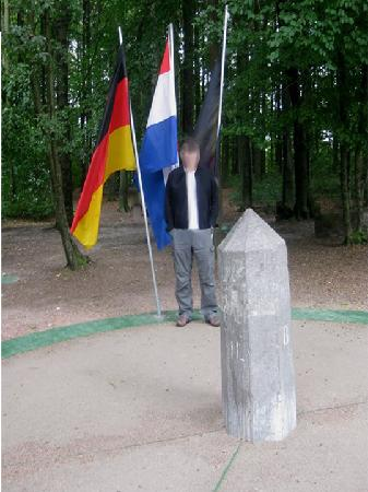 Drielandenpunt: The marker stone and flags at the triple border