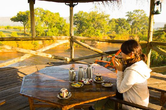 Cheetah Tented Camp: Private terrace having morning coffee/tea