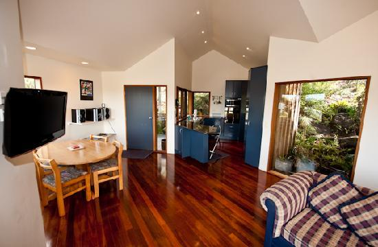 Sandspit Retreat : 1 bedroom cottage View to full working Kitchen from Lounge