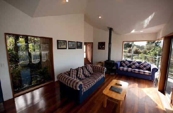 Sandspit Retreat: 1 bedroom cottage View from Lounge to Bedroom including Fireplace