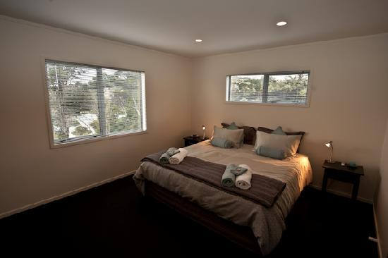 Sandspit Retreat: 3 Bedroom house's Master Bedroom and Ensuite