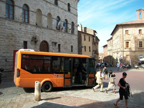 Orange bus from bottom of hill takes you thru narrow streets to the Piazza Grande at top.