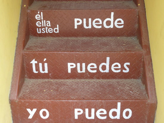 Latin American Spanish School: The stairs with the verbs at the entrance