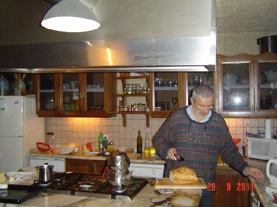 Ortahisar, Turkey: Mr. Kazuk slices the bread he cooked.