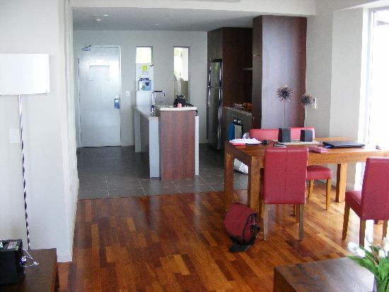 Whitsunday Reflections: living room looking back to kitchen