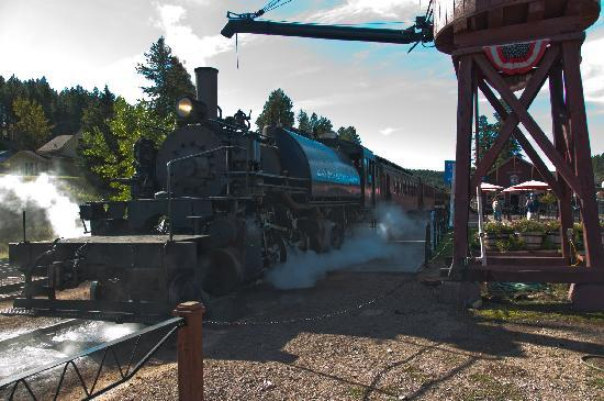 Best Western Golden Spike Inn & Suites: Black Hills Central RR Engine 110 Leaving Hill City, SD Depot