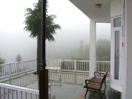 Dhanachuli, India: View from the front Deck in rains