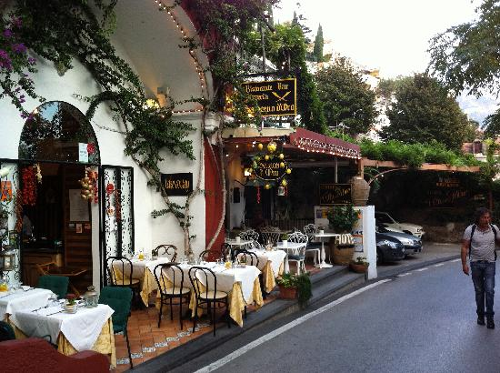 Hotel Villa delle Palme: Street view of restaurant and entrance to inn