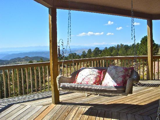 Whispering Pines Bed and Breakfast and Vacation Home Rental: Our Favorite place to sit on their Great deck with views of the whole Sangre De Cristo range!