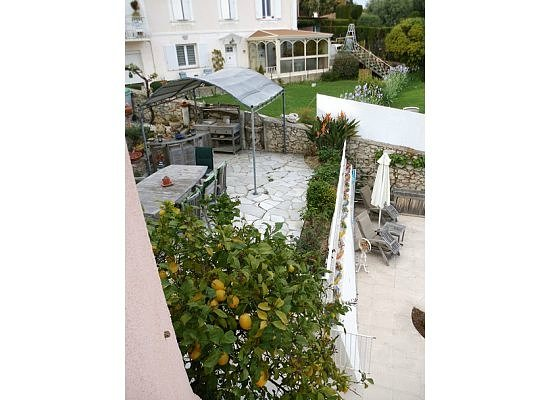 Maison Louijane: View from Chambre Jean of the outdoor dining area and solarium of main house where breakfast ser