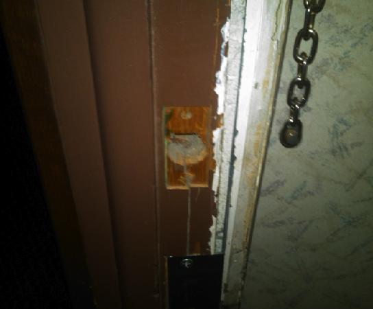 National 9 Inn Gillette: wood completely broken around dead bolt