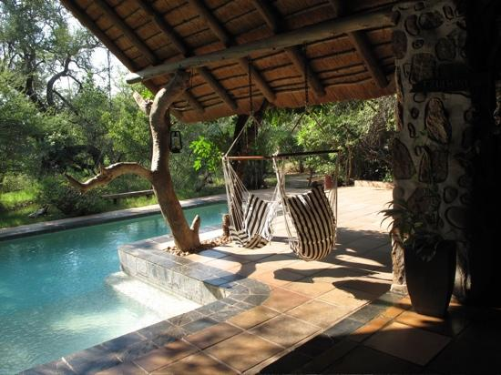 Ezulwini Game Lodges: pool area where we lounged during the day
