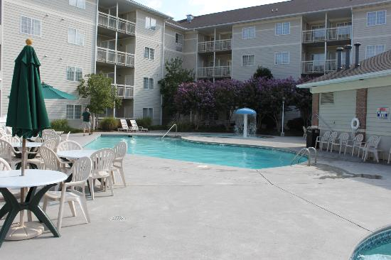 MainStay Suites: View of the outdoor pool standing beside the lazy river