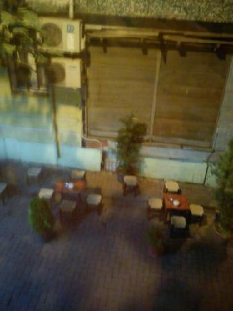 Melita Hotel: view of littles tables outside the hotel where the men sit and play games.