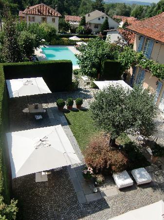 Corte Gondina Boutique Hotel: Vue de la chambre sur jardin et piscine