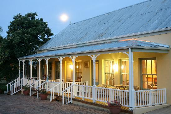 Housemartin Guest Lodge: Beautiful summer evenings on your private garden-facing verandah.
