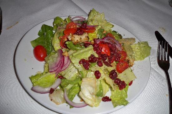 Fleming's Prime Steakhouse & Wine Bar: FLEMING'S SALAD :seasonal greens, candied walnuts, dried cranberries, tomatoes, onions and crout
