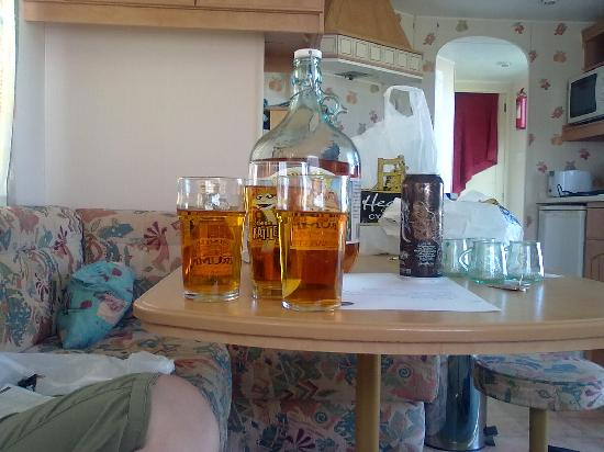 Trenance Holiday Park: The inside of the caravan with our cornish Cyder from the cyder farm(only a short drive away)