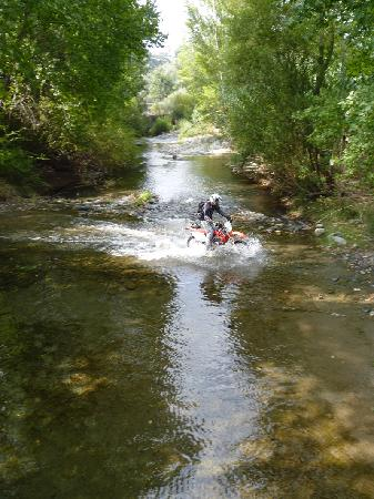 Riders of the Lost Trail - Guided Off Road Motorcycle Trail Tours: Phil crossing the river Genal.