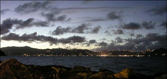Tradewinds Restaurant @ Peter Island Resort: view of Tortola's lights twinkling in the distance as the sun set.