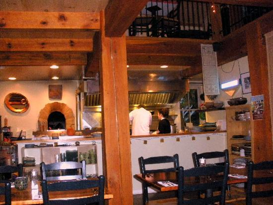 Montrose, PA: View of the open kitchen with wood fired overn