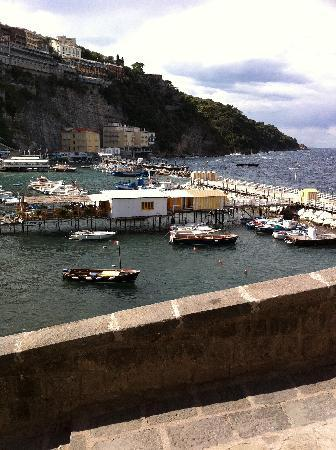 Hotel Admiral Sorrento: Hotel is 2nd yellow building at the right of picture. Taken from steps on the way to town