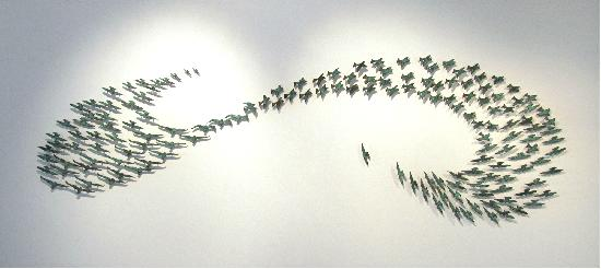 TOI Gallery : A bronze wall sculpture by Waiheke artists Sally Smith called Godwits Return