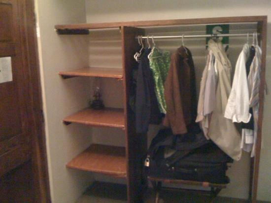 Missing Closet Doors And Crooked Cheap Plastic Film Wrapped Shelves